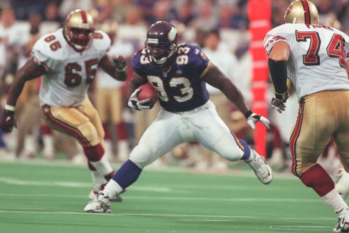 Minneapolis Mn , Vikings vs San Francisco 10/24/99—Vikings defensive tackle John Randle tries to avoid San Francisco√≠s Ray Brown (65), Dave Fiore after Randle intercepted a pass thrown by Jeff Garcia during the 2nd quarter. The interception was his