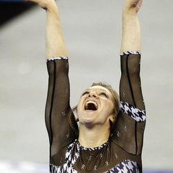 Alabama's Geralen Stack-Eaton reacts after finishing her routine on the balance beam during the NCAA women's individual gymnastics championships, Sunday, April 22, 2012, in Duluth, Ga. Stack-Eaton won the event.