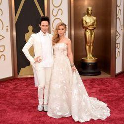 "Johnny Weir and Tara Lipinski (in Rani Zakhem)! They apparently went for an ""<a href=""http://instagram.com/p/lDokwusosI/""target=""_blank"">angel theme</a>."""