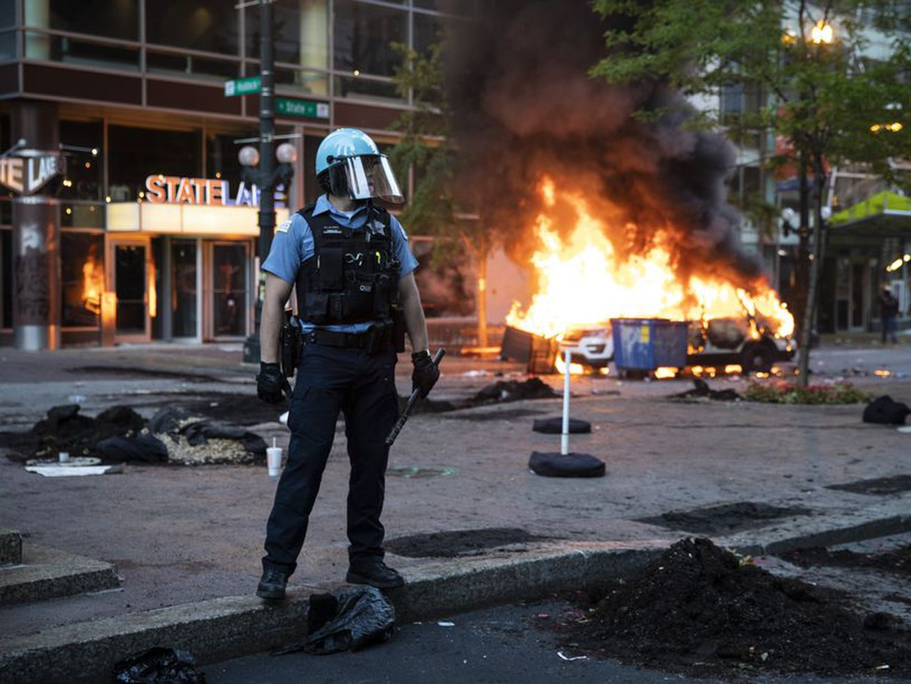 A Chicago Police Department SUV burns near State and Lake streets in the Loop on May 30, 2020, as thousands of protesters in Chicago joined national outrage over the killing of George Floyd in Minneapolis police custody.