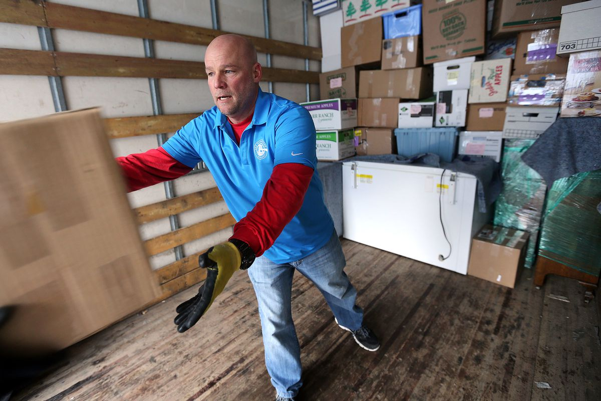 FILE - Dave Durocher, managing director of The Other Side Academy, helps move a client's home in Olympus Cove on Thursday, Jan. 7, 2016.