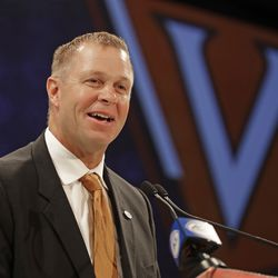 Virginia head coach Bronco Mendenhall answers a question during a news conference at the NCAA Atlantic Coast Conference college football media day in Charlotte on July 18, 2018.
