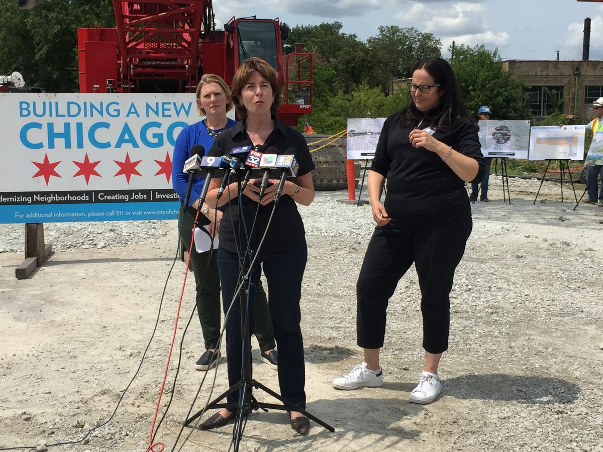 Ald. Margaraet Laurino, center, announces the end of the blasting operation phase with CDOT Commissioner Rebekah Scheinfeld (left) and Mariyana Spyropoulos, president of the Metropolitan Water Reclamation District of Greater Chicago.   Rachel Hinton / Sun