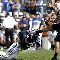 Brigham Young Cougars linebacker Kyle Van Noy blocks a punt by Idaho State Bengals punter David Harrington as Brigham Young University faces Idaho State in NCAA football in Provo, Saturday, Oct. 22, 2011.