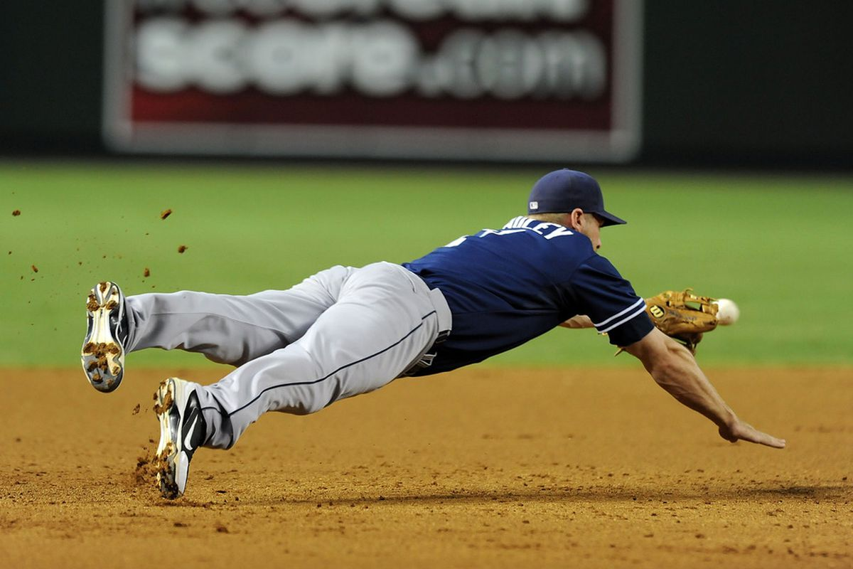 Chase Headley diving. When did you last see A-Rod stretch like that? It was before you reached puberty, right?  (Photo by Norm Hall/Getty Images)