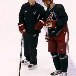 Phoenix Coyotes head coach Dave Tippett, left, skates with Michal Rozsival, of the Czech Republic, during practice on Wednesday, April 11, 2012, in Glendale, Ariz.  The Coyotes and the Chicago Blackhawks are scheduled to play Game 1 of an NHL hockey Western Conference quarterfinal series on Thursday.