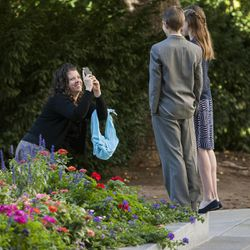 Shera Mae Walker takes a photo of two of her children, David and Anna Mea prior ton the morning session of the 183rd Semiannual General Conference for The Church of Jesus Christ of Latter-day Saints Sunday, Oct. 6, 2013, outside the Conference Center.