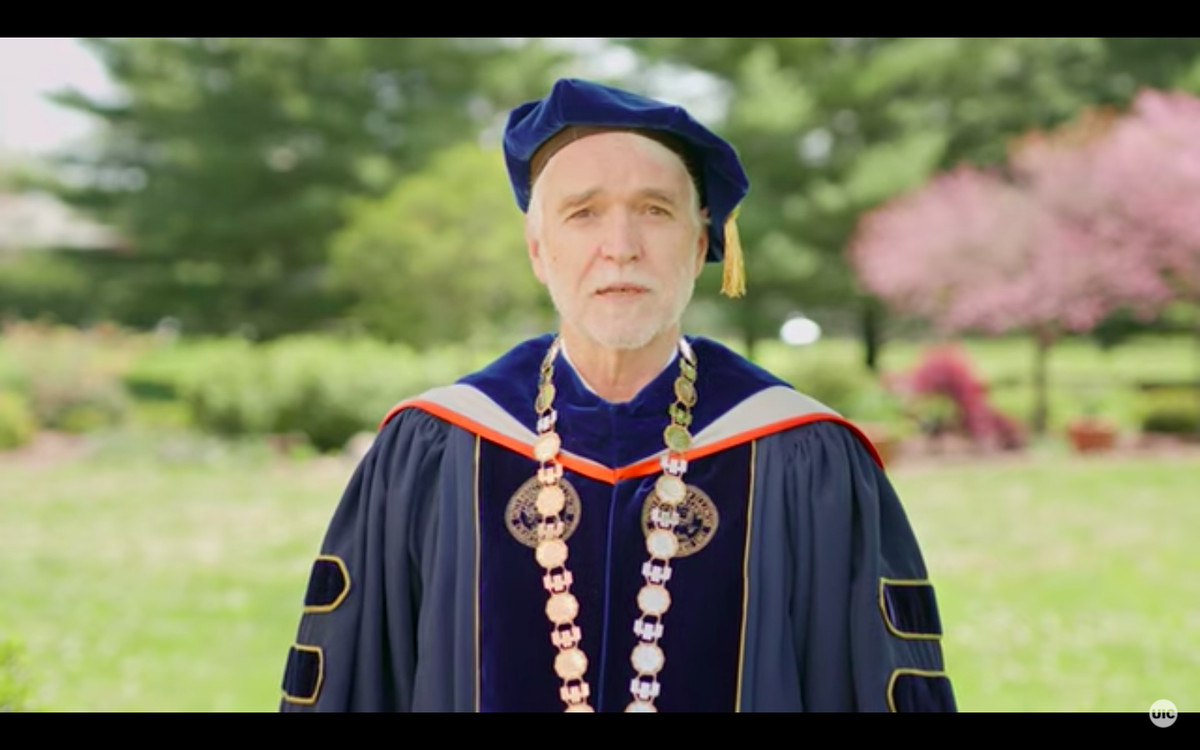 University of Illinois System President Timothy Killeen delivers a pre-recorded commencement speech issued to UIC grads Saturday.