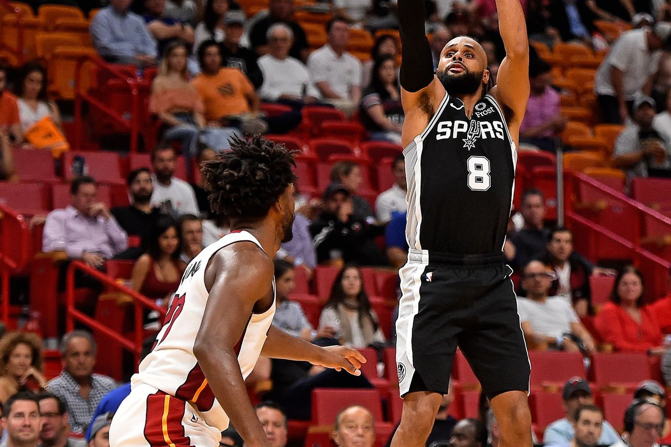 Mills led the Spurs with 20 points in Miami.
