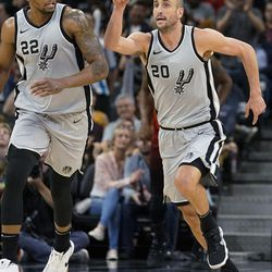 San Antonio Spurs' Manu Ginobili (20) and Rudy Gay celebrate a basket during the second half of the team's NBA basketball game against the Utah Jazz, Friday, March 23, 2018, in San Antonio. San Antonio won 124-120 in overtime. (AP Photo/Darren Abate)