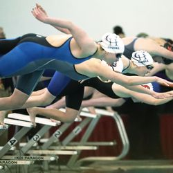 Swimmers prepare to race at the 6A girls swim championship at Kearns Oquirrh Park Fitness Center in Kearns on Saturday, Feb. 20, 2021.