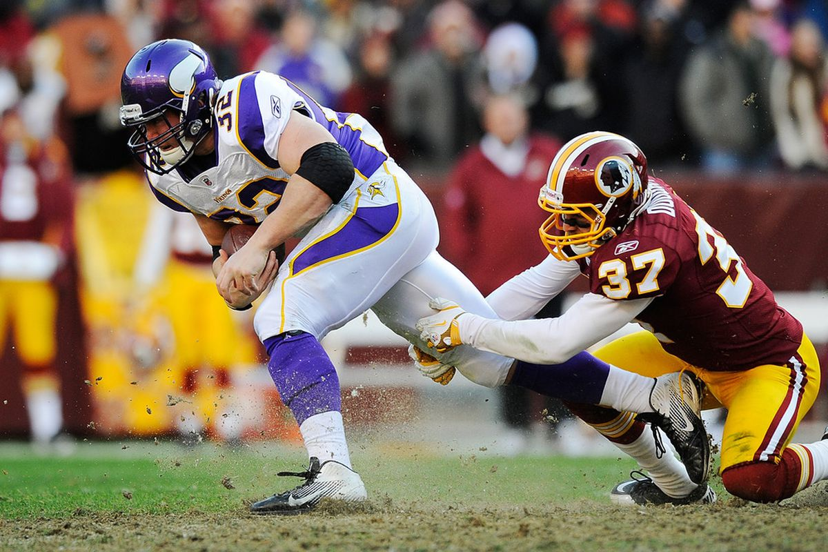 LANDOVER, MD - DECEMBER 24:  Toby Gerhart #32 of the Minnesota Vikings breaks the tackle of Reed Doughty #37 of the Washington Redskins during a game at FedExField on December 24, 2011 in Landover, Maryland.  (Photo by Patrick McDermott/Getty Images)