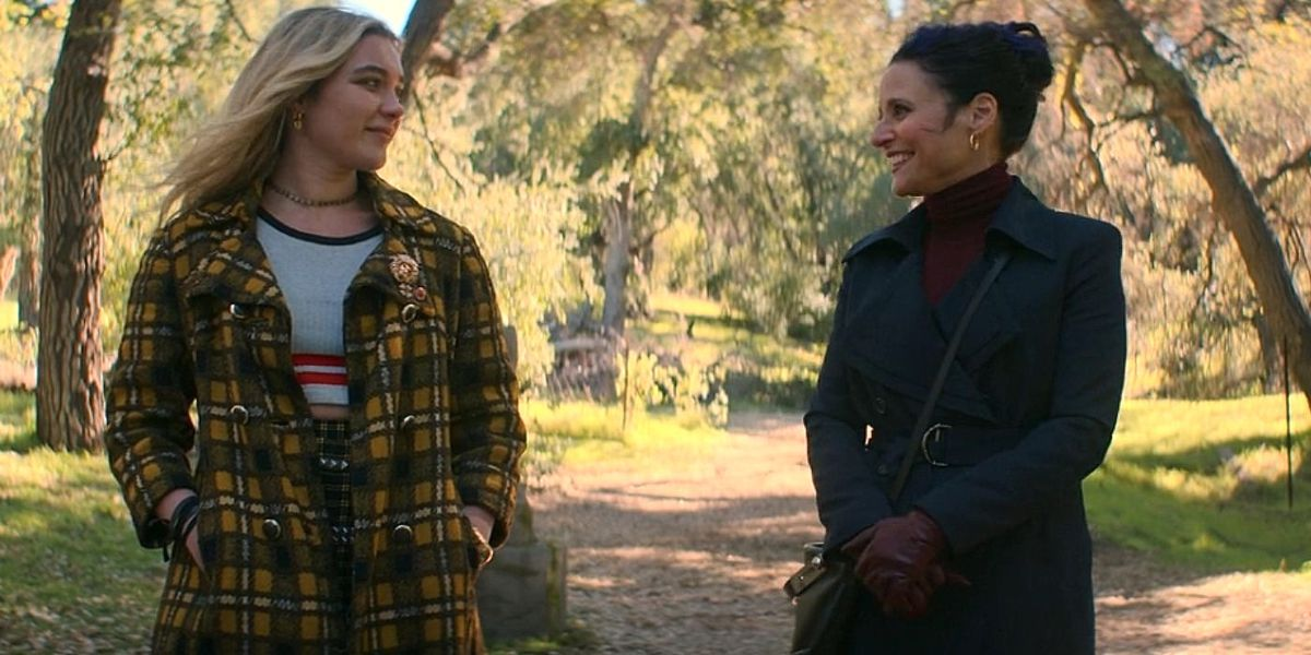 Yelena (Florence Pugh) and Valentina (Julia Louis-Dreyfus) smile cheerfully at each other in front of Natasha's grave, because, I mean, why not?