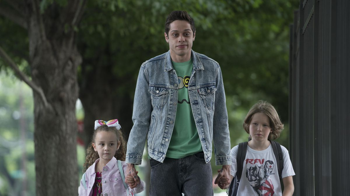 a man walks two children to school
