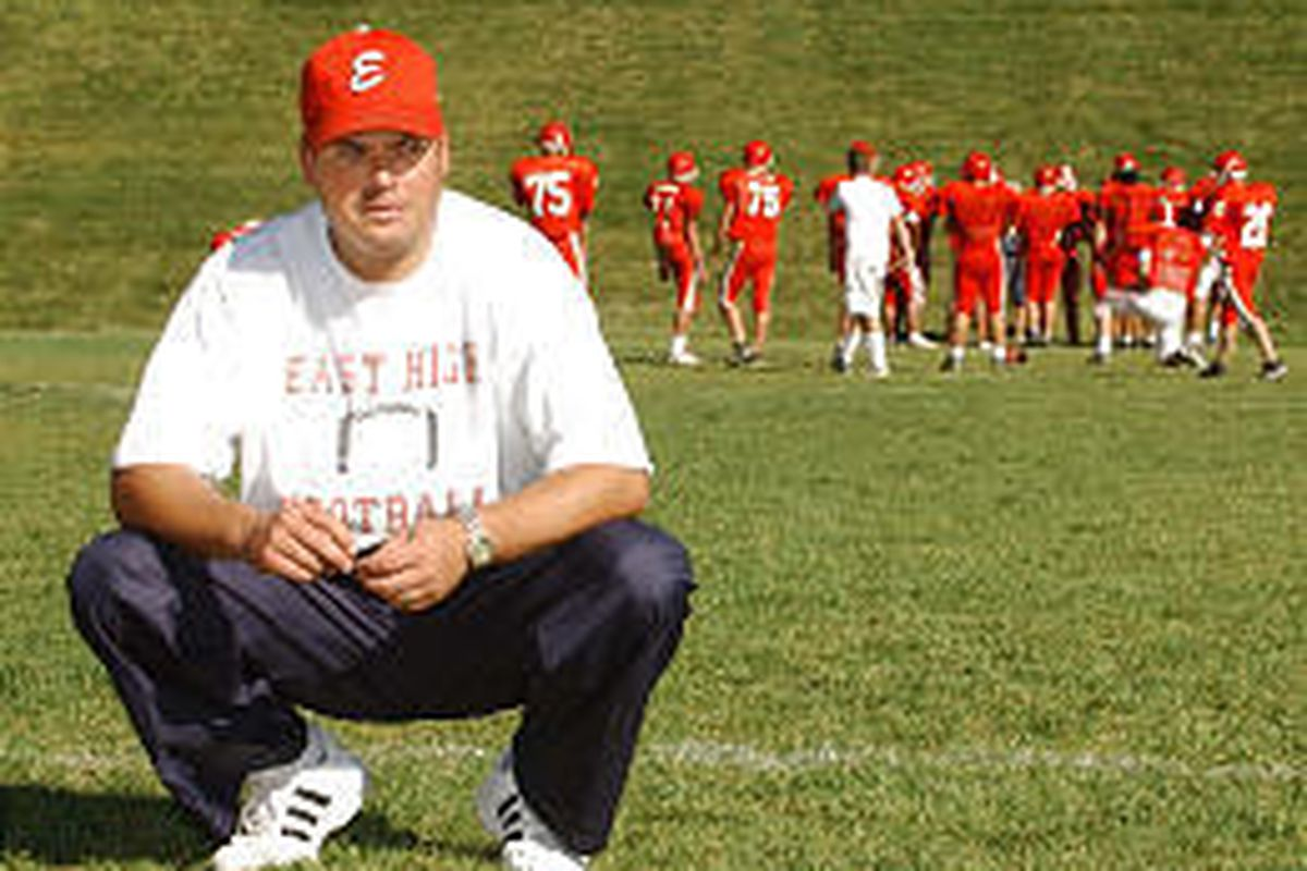 First-year East head football coach Aaron Whitehead conducts practice at the Salt Lake high school.