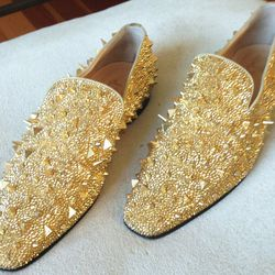 """Christian Louboutin gold spiked studded shoes, $1,500. """"Mr. Louboutin gave me these for Christmas. That's all!"""""""