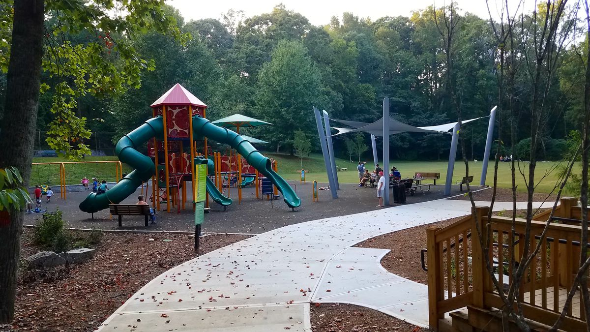 Playground with climbing structure and covered benches.