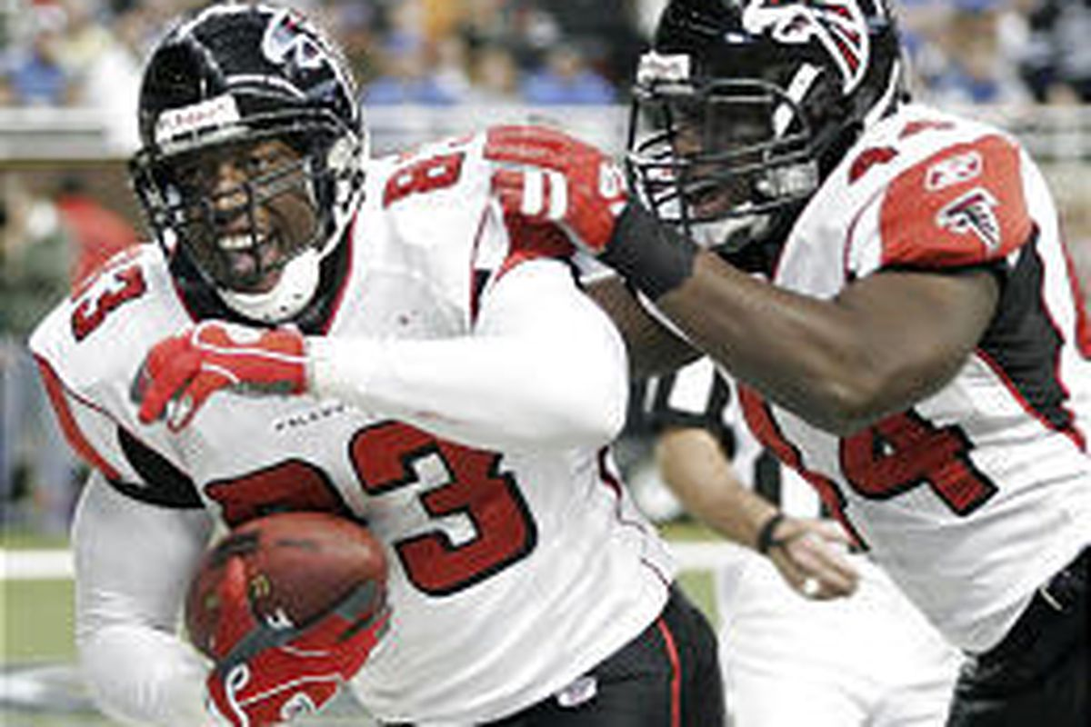 Atlanta Falcons tight end Alge Crumpler, left, celebrates his 6-yard touchdown Thursday with teammate Fred McCrary.