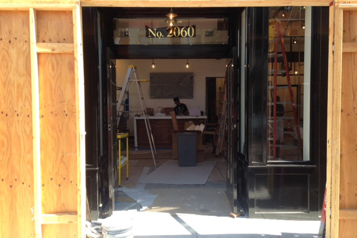 Go ahead. Peer beyond the plywood into the Fillmore Rag & Bone space.