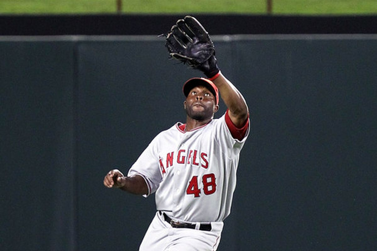 ARLINGTON TX - JULY 22:  Torii Hunter #48 of the Los Angeles Angels of Anaheim makes the fly out against Bengie Molina of the Texas Rangers on July 22 2010 at Rangers Ballpark in Arlington Texas.  (Photo by Ronald Martinez/Getty Images)