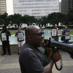 Activist Ali Muhammad with the National Black United Front leads a protest of about 15 people calling for answers from city officials about why a police officer on Saturday fatally shot Brian Claunch, Tuesday, Sept. 25, 2012, outside City Hall in Houston. Claunch, a wheelchair-bound double amputee living in a group home for the mentally ill, was shot and killed by Houston Police in the early morning hours Saturday. Police say HPD officer Matthew Martin shot and killed Claunch, who was waving an object in his hand that turned out to be a pen.