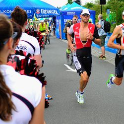 Timo Bracht of Germany (R) and Dirk Bockel of Luxembourg compete during the run leg of Challenge Roth on July 20, 2014 in Roth, Germany. (Photo by Lennart Preiss/Getty Images)