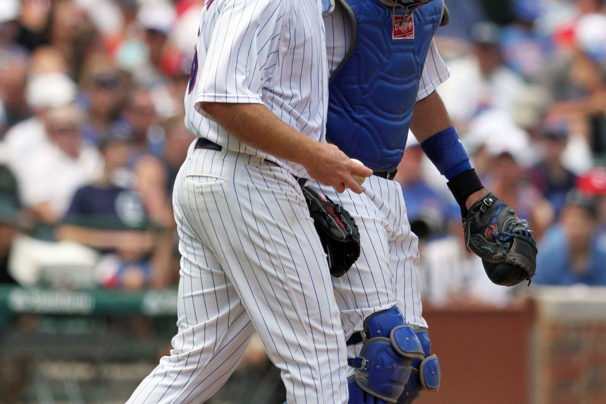 Ryan Dempster and Geovany Soto of the Chicago Cubs talk during play against the Arizona Diamondbacks at Wrigley Field in Chicago, Illinois. (Photo by Tasos Katopodis /Getty Images)
