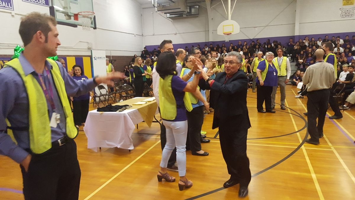 Adams 14 Superintendent Javier Abrego celebrates with teachers at Kearney Middle School during an event highlighting the school's rating in August 2017. (Photo by Yesenia Robles, Chalkbeat)