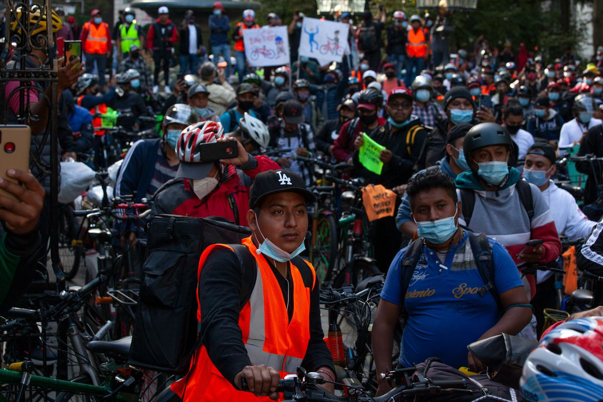 Hundreds of delivery cyclists packed into City Hall Park to call for job protections.