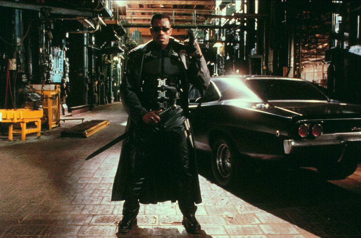 Wesley Snipes stands in a street with sword in hand from the movie Blade