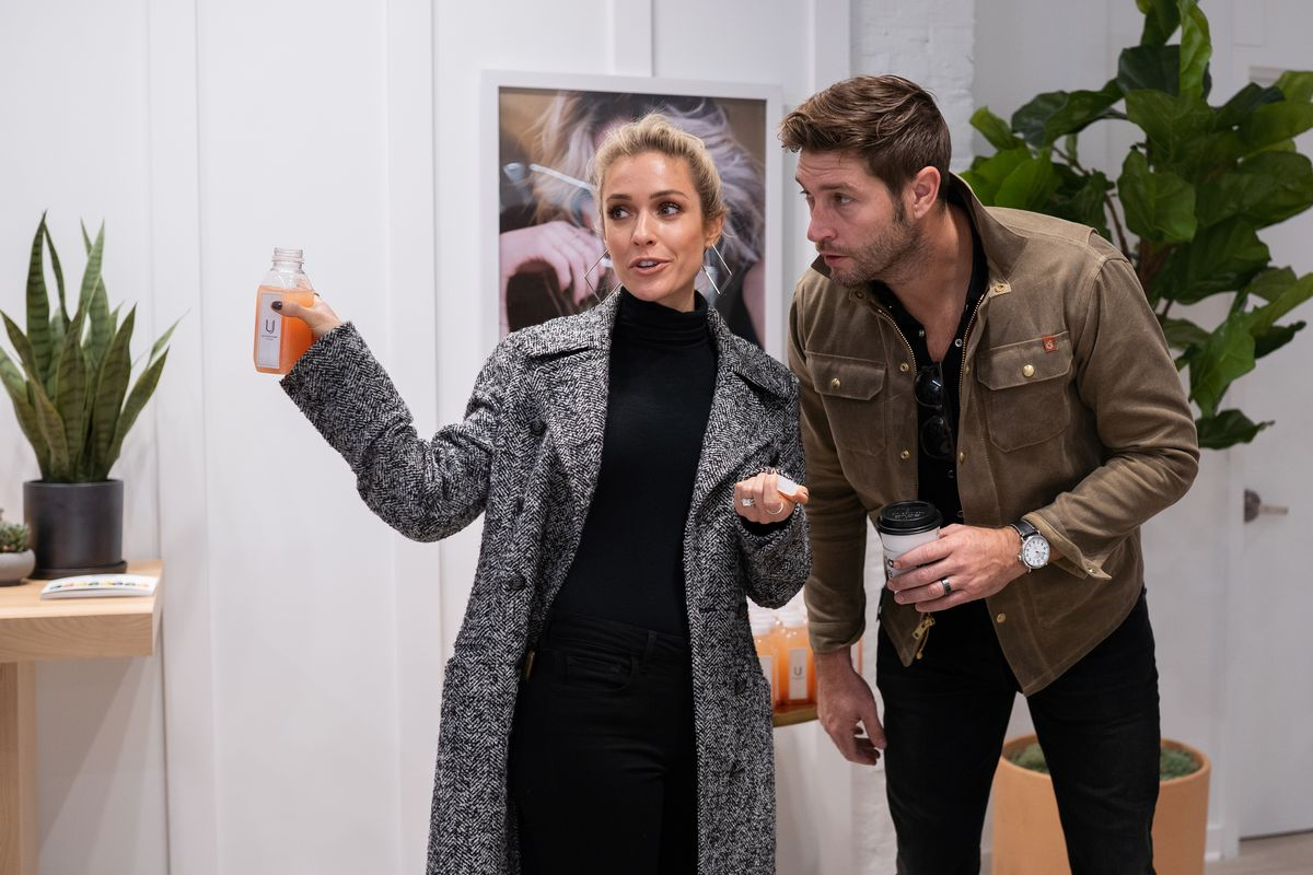 Kristin Cavallari, founder of Uncommon James, and her husband Jay Cutler, talk during the opening of her store's West Loop location in October 2019.