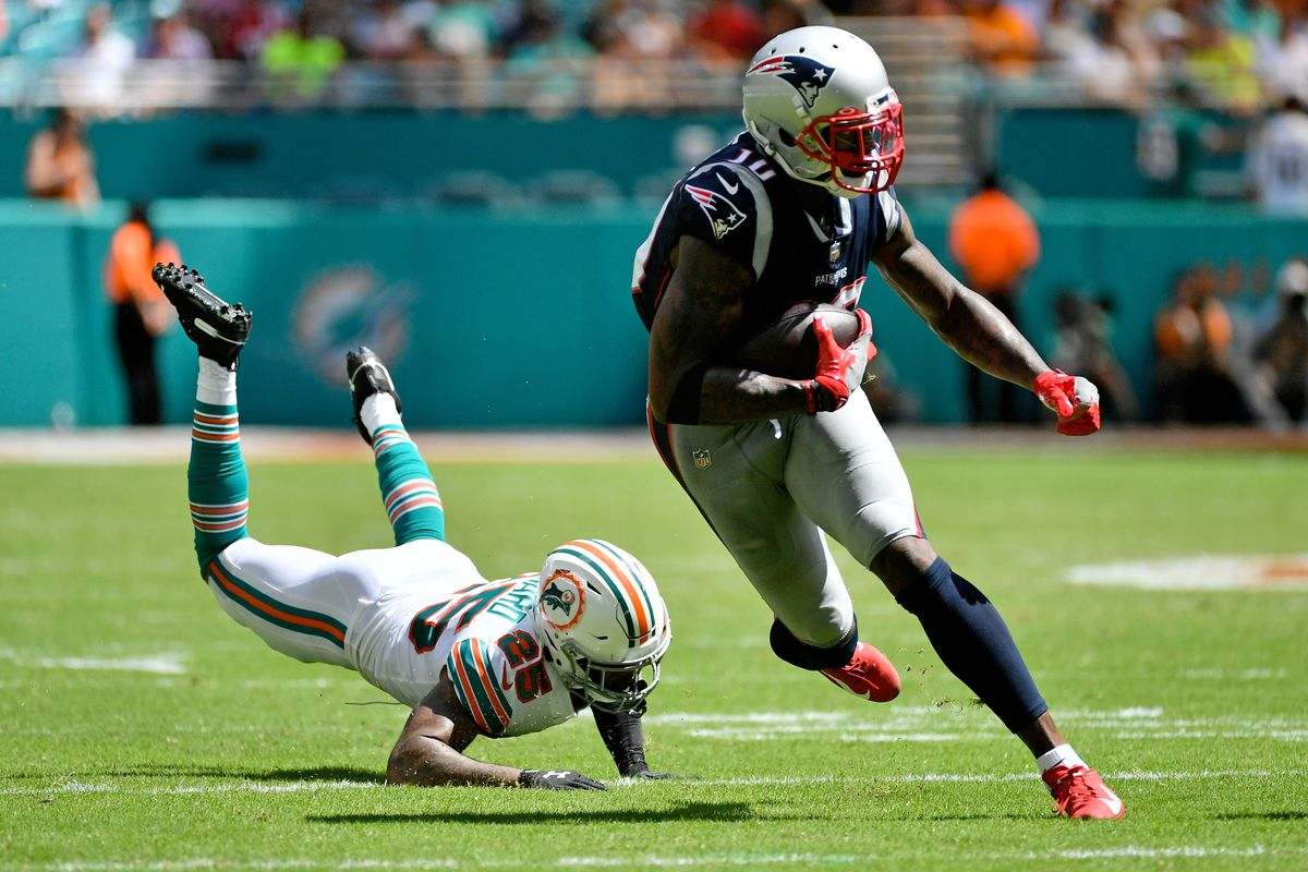 New England Patriots wide receiver Josh Gordon runs with the ball after breaking the tackle of Miami Dolphins cornerback Xavien Howard during the second half at Hard Rock Stadium.