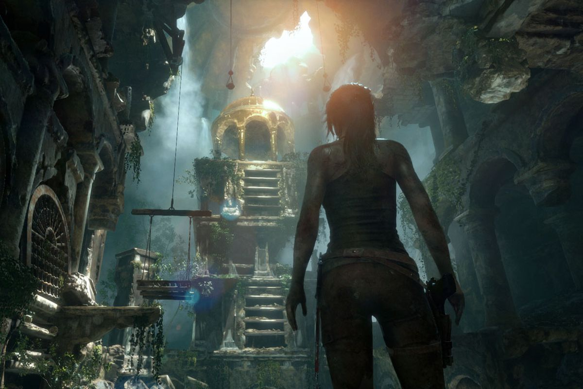 Lara Croft gazes upon an underground temple in a screenshot from Rise of the Tomb Raider