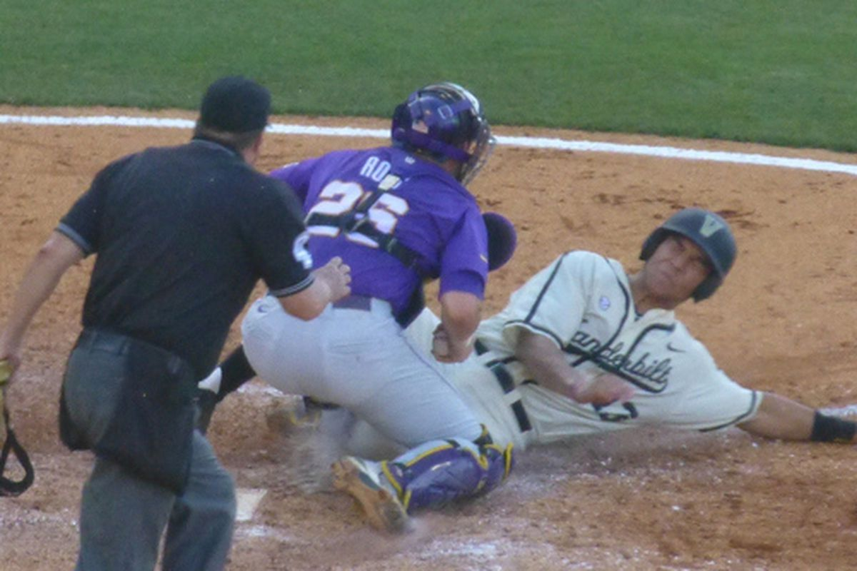LSU's C Ty Ross prevents Vandy's DH Zander Wiel from scoring after catching a perfect throw from RF Jared Foster