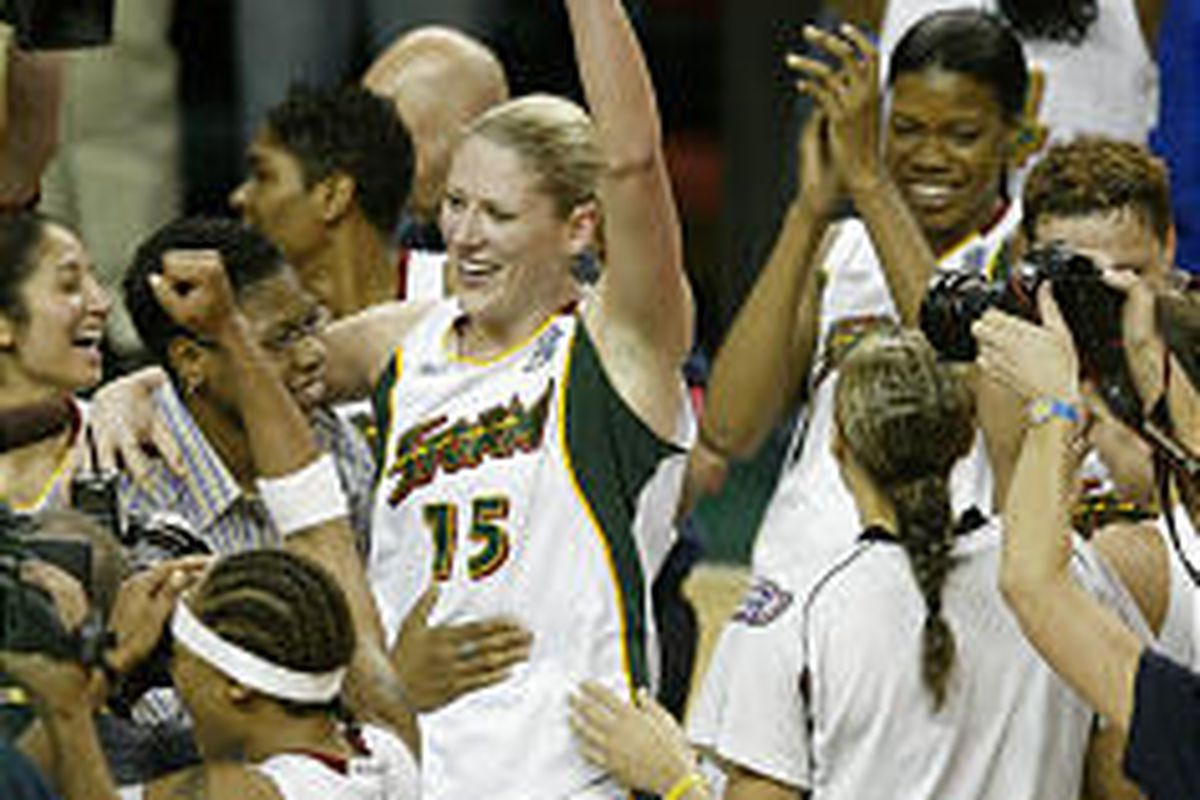 Storm's Lauren Jackson (15) and her teammates celebrate Seattle's first professional sports championship in 25 years on Tuesday night.