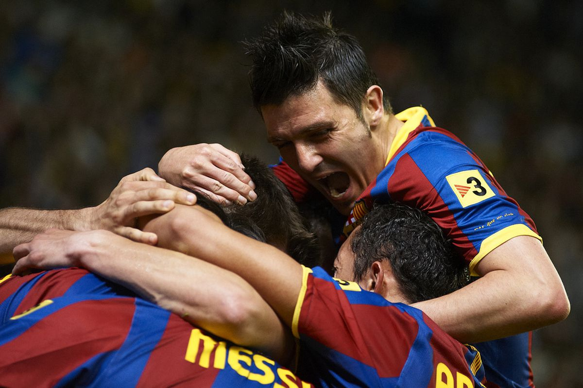 VILLARREAL, CASTELLON - APRIL 02: David Villa of Barcelona celebrate with his teammate during the La Liga match between Villarreal and Barcelona at El Madrigal on April 2, 2011 in Villarreal, Spain.  (Photo by Manuel Queimadelos Alonso/Getty Images)