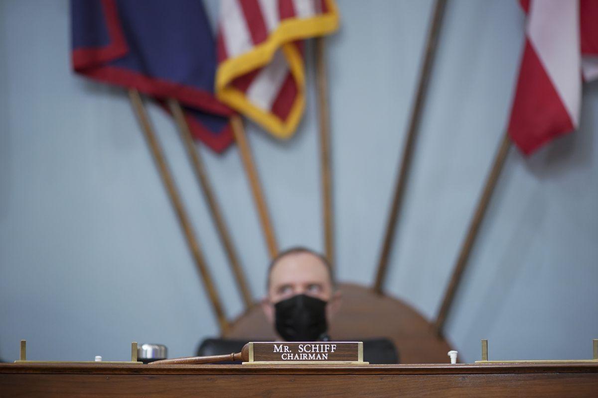Representative Adam Schiff sits next to a gavel.