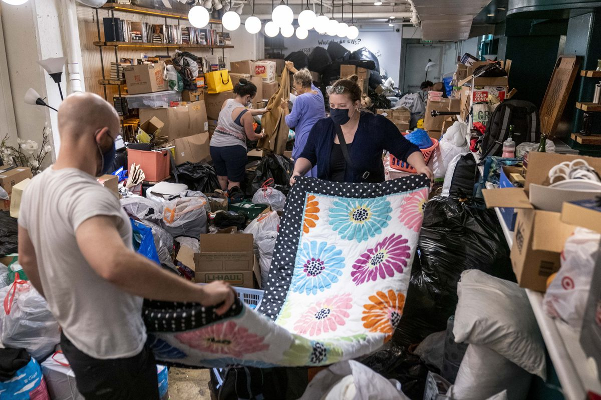 Volunteers sort items donated to refugees from Afghanistan.