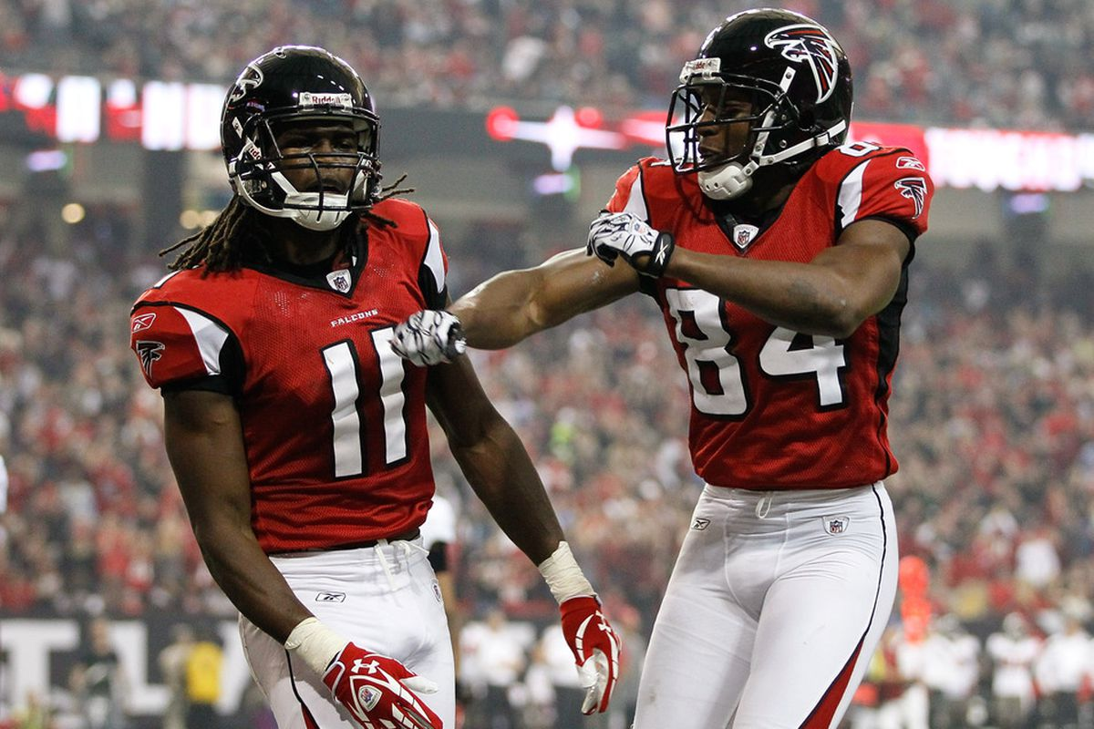 ATLANTA, GA - JANUARY 01:  Julio Jones #11 and Roddy White #84 of the Atlanta Falcons celebrate Jones' touchdown against the Tampa Bay Buccaneers at Georgia Dome on January 1, 2012 in Atlanta, Georgia.  (Photo by Kevin C. Cox/Getty Images)