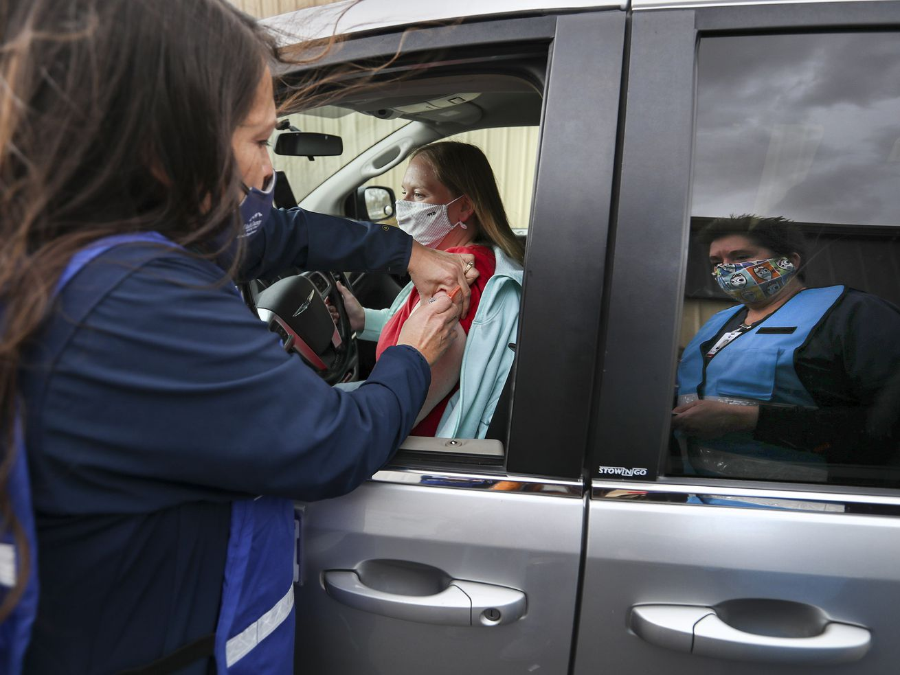Tonya Hansen, a registered nurse with the Utah County Health Department, gives Brooke Barnes a flu shot during a drive-thru flu shot clinic at the Spanish Fork Fairgrounds on Wednesday, Nov. 18, 2020.