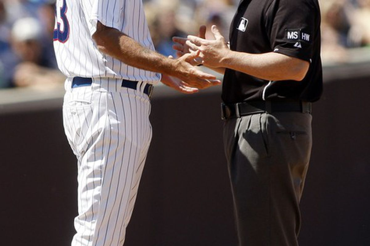 Chicago, IL, USA; Chicago Cubs manager Dale Sveum argues with second base umpire Eric Cooper after being ejected against the Chicago White Sox at Wrigley Field. Credit: Jerry Lai-US PRESSWIRE