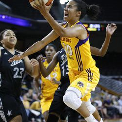 Los Angeles Sparks' Kristi Toliver goes up for a shot as San Antonio Silver Stars' Danielle Adams, background left, watches during Game 1 of a WNBA basketball first-round playoff series, in Los Angeles on Thursday, Sept. 27, 2012.