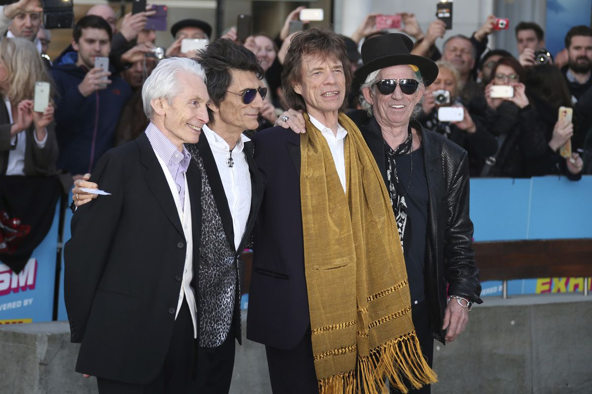 """Charlie Watts (from left), Ronnie Wood, Mick Jagger and Keith Richards attend the Rolling Stones """"Exhibitionism"""" preview in London in 2016."""