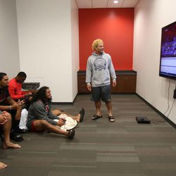 From left, Moana Ofahengaue, Soni Kinikini, Clarence Smith 4th, Thretton Palamo, and L.T. Filiaga watch and play video games in the new Spence and Cleone Eccles Football Center at the University of Utah in Salt Lake City on Thursday, Aug. 15, 2013.