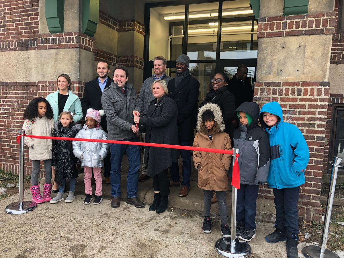 Kyle Smitley, back left, stands with members of Capital Impact Partners, a nonprofit fund that supported the renovation of Detroit Prep.