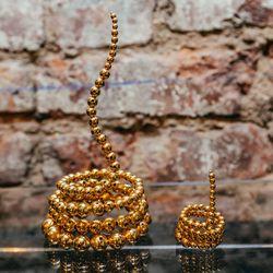 "<b>Paula Mendoza</b> Nereus Bracelet, <a href=""http://owennyc.com/shop-women/women-designers/women-paulamendoza/nereus-bracelet.html"">$550</a>, and Triple Adriane Ring, <a href=""http://owennyc.com/shop-women/women/women-jewelry/triple-adriane-ring.html"">"
