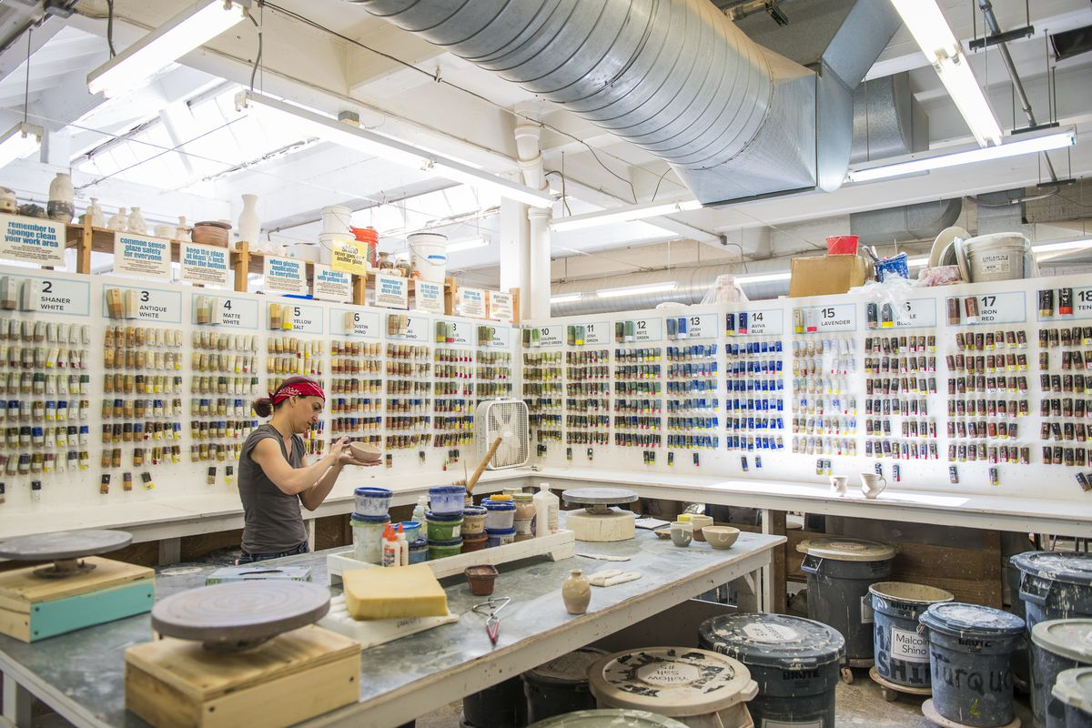 A woman adds finishing touches to a ceramic bowl before selecting a color to glaze her bowl at the Lillstreet Art Center in the 4400 block of North Ravenswood Avenue in Ravenswood.   Tyler LaRiviere/Sun-Times