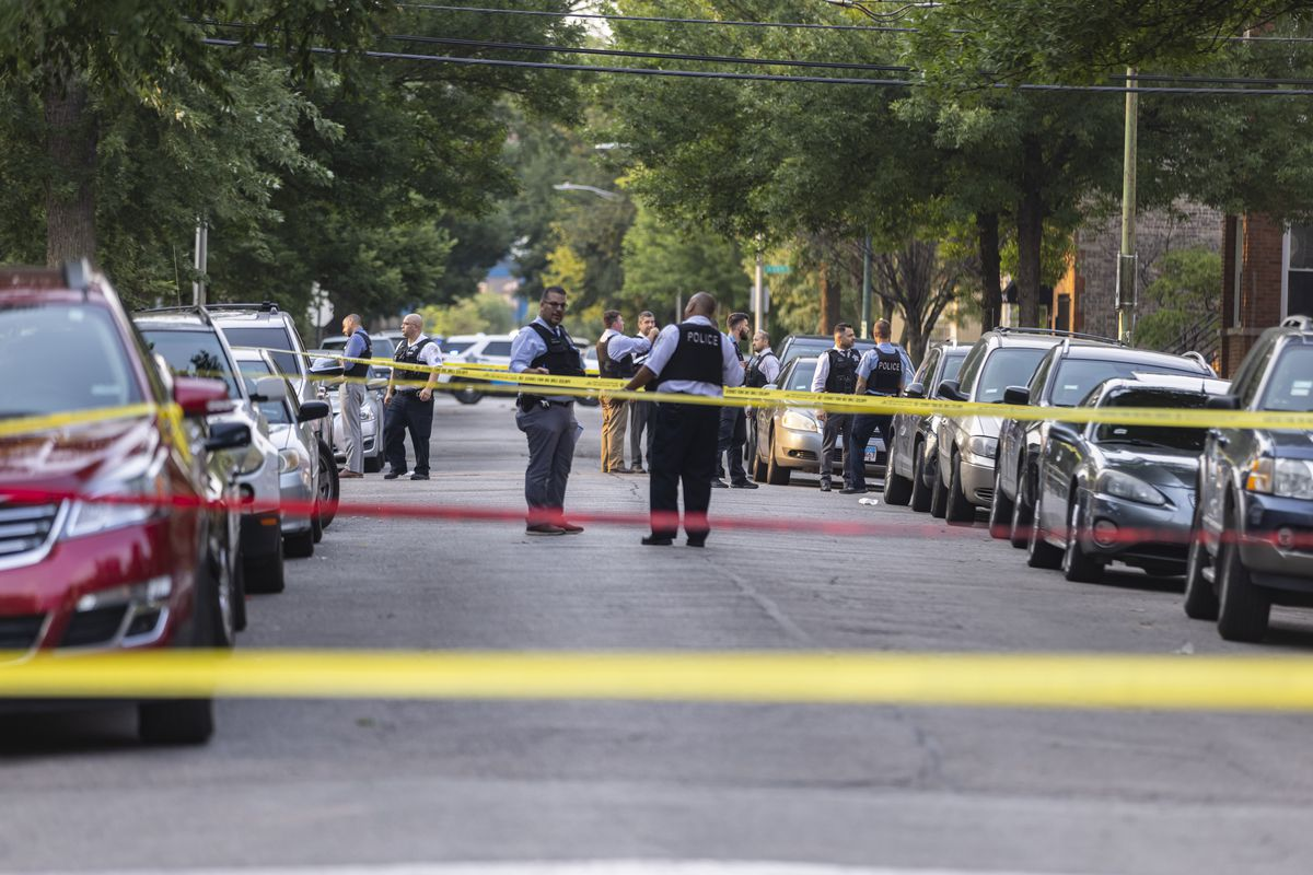 Police investigate the scene near a mass shooting in North Lawndale on Wednesday, July 21, 2021.