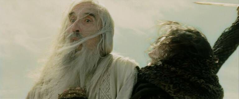 Wormtongue stabs Saruman into the two towers.