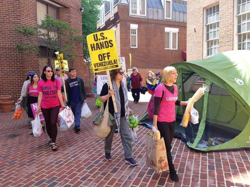 Members of Code Pink try to enter the backside of the Venezuela embassy on May 2, 2019.